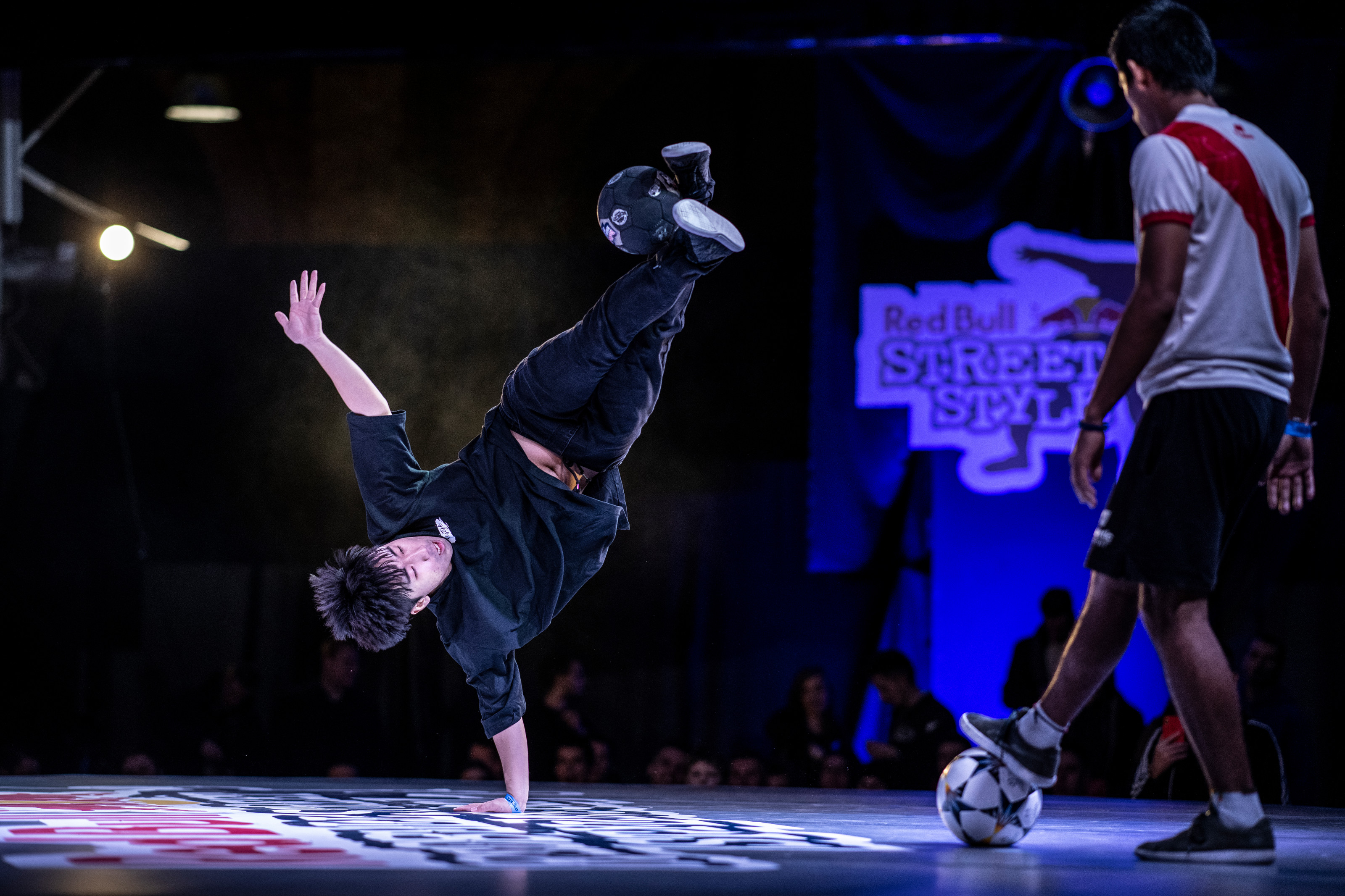 "Park ""Jinkun"" Suk of South Korea competes against Luis Venancio (R) of Peru during qualifications for the Red Bull Street Style World Final at Hala Gwardii, Warsaw, Poland on November 21, 2018."